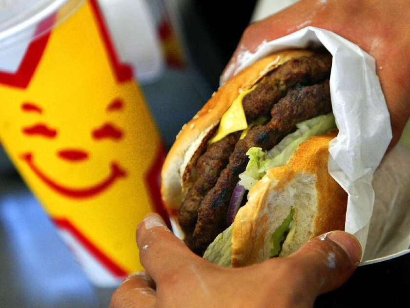 Advertisements for fast food prompted more activity in the reward centers of overweight and obese teens' brains than they did in those of lean adolescents, says a new study. Even the brain areas in which the mouth is represented responded to advertisements showing high-fat, high-calorie foods.
