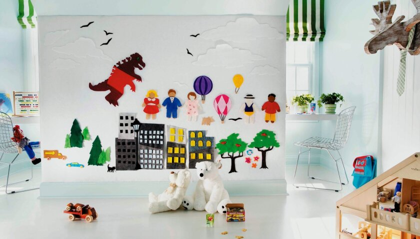 Artwork created with felt decorates a wall in a boy's playroom designed by Brian Patrick Flynn for HGTV.com.