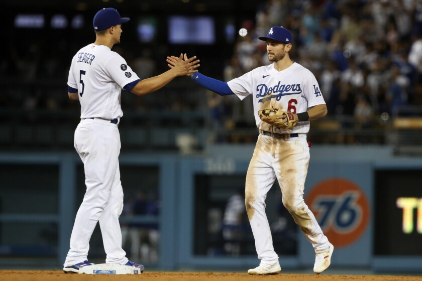 Dodgers shortstop Corey Seager, left, and second baseman Trea Turner celebrate the Dodgers' win Aug. 7, 2021.