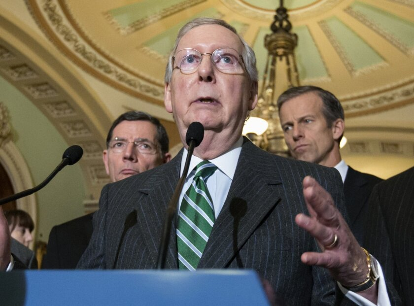 FILE - In this Feb. 9, 2016 file photo, Senate Majority Leader Mitch McConnell of Ky. speaks on Capitol Hill in Washington. State and local governments would be permanently barred from taxing access to the Internet under a bipartisan compromise the Senate began pushing toward final congressional ap
