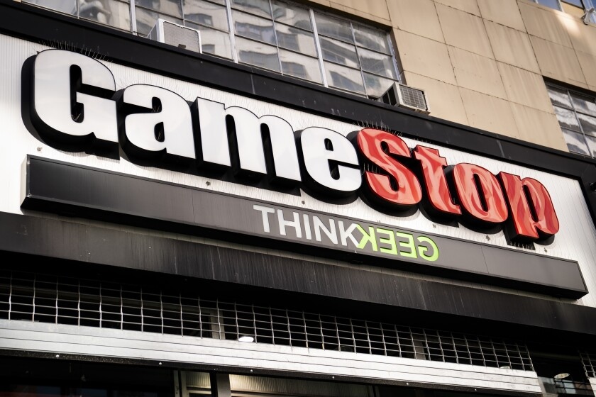 Pedestrians pass a GameStop store on 14th Street at Union Square, Thursday, Jan. 28, 2021, in the Manhattan borough of New York. Robinhood and other online trading platforms are moving to restrict trading in GameStop and other stocks that have soared recently due to rabid buying by smaller investors. GameStop stock has rocketed from below $20 to more than $400 this month as a volunteer army of investors on social media challenged big institutions who has placed market bets that the stock would fall. (AP Photo/John Minchillo)