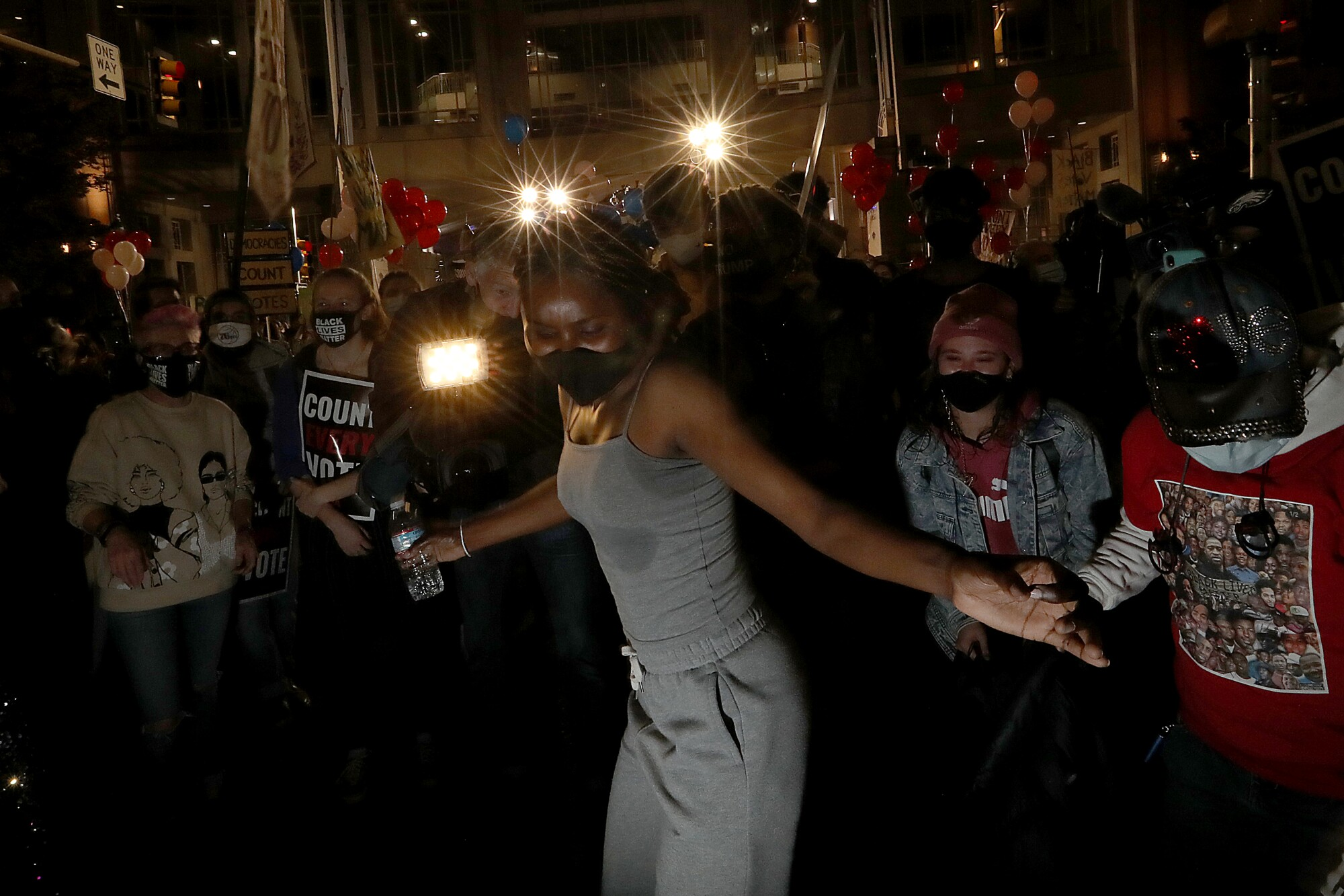 Protesters dance in the dark