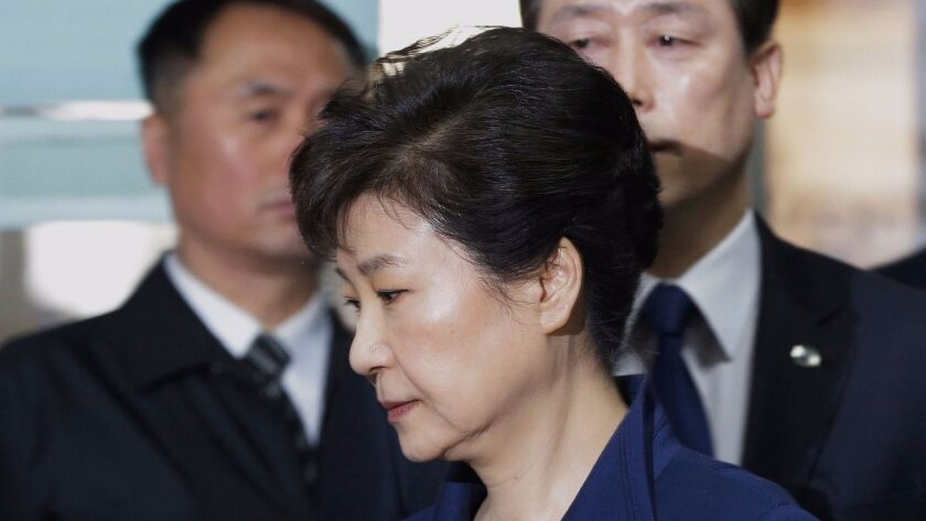 Ousted South Korea President Park Geun-Hye arriving for questioning on her arrest warrant at the Seoul Central District Court in Seoul in March.