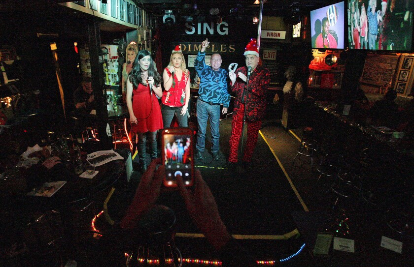 America's first karaoke bar' Dimples to sing itself out