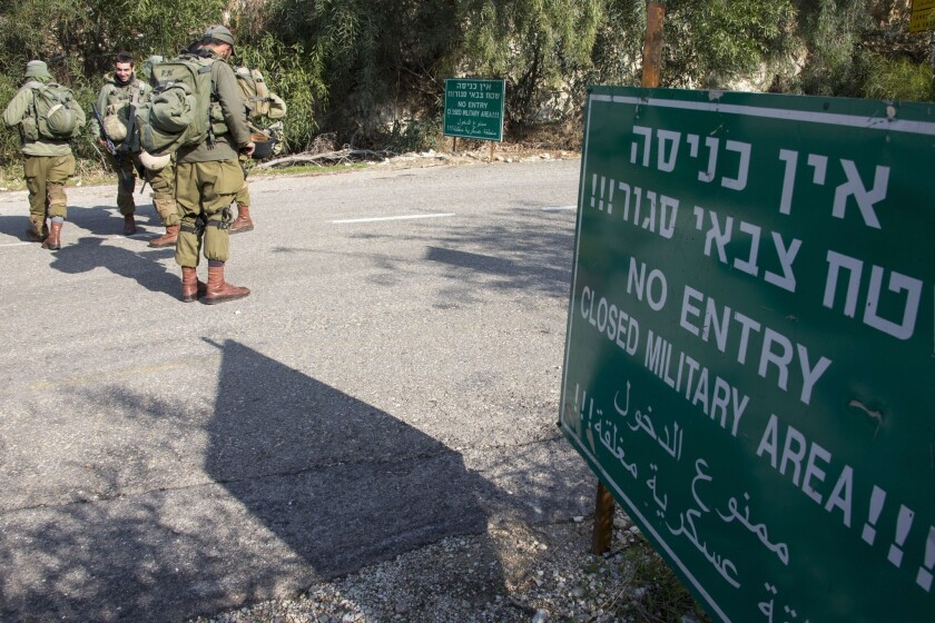 Israeli soldiers control access to one of the roads near the Israeli-Lebanese border Monday.