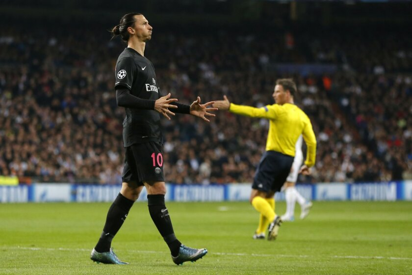 PSG's Zlatan Ibrahimovic reacts during his Group stage of Champion's League Group A soccer match against Real Madrid at the Santiago Bernabeu stadium in Madrid, Spain, Tuesday, Nov.3, 2015. (AP Photo/Daniel Ochoa de Olza)