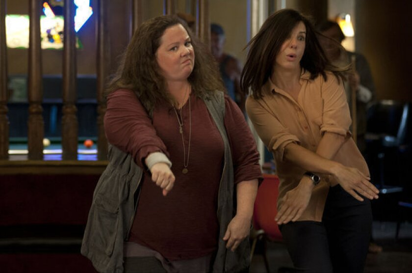 """Melissa McCarthy and Sandra Bullock in a scene from """"The Heat."""""""