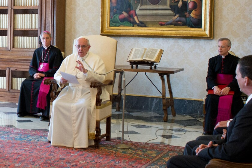 Pope Francis speaks with a delegation from the International Catholic Child Bureau at the Vatican on Friday.
