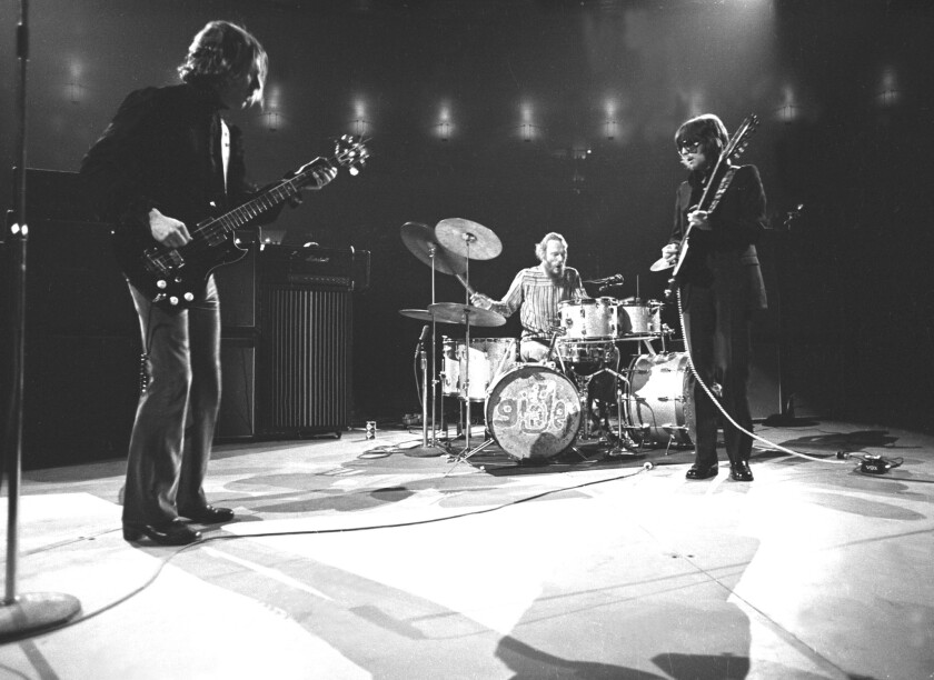 Cream is shown performing on its U.S. farewell tour at New York's Madison Square Garden on Nov. 2, 1968, shortly after the trio's late-October concert at the San Diego Sports Arena. Shown from left to right are Jack Bruce, Ginger Baker and Eric Clapton, who is the band's only surviving member.