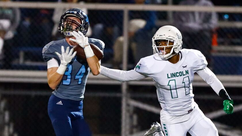 Otay Ranch defensive back Nathen Castro intercepts a pass in the Mustangs' quarterfinal win over Lincoln.