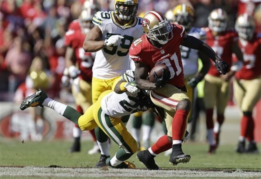 San Francisco 49ers wide receiver Anquan Boldin (81) runs past Green Bay Packers defensive back Jerron McMillian (22) during the fourth quarter of an NFL football game in San Francisco, Sunday, Sept. 8, 2013. The 49ers won 34-28. (AP Photo/Ben Margot)