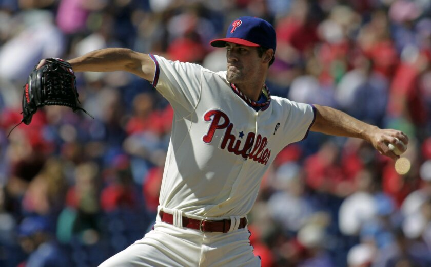 Philadelphia Phillies starting pitcher Cole Hamels throws against the Atlanta Braves in the first inning of a baseball game Sunday, Sept. 28, 2014, in Philadelphia. (AP Photo/H. Rumph Jr)
