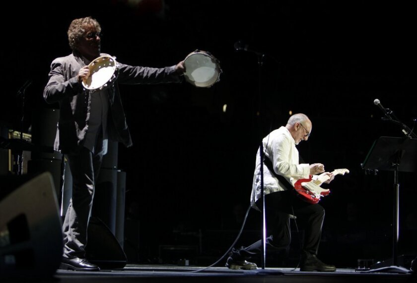"""Roger Daltrey, left, and Pete Townshend perform """"The Real Me"""" during the Who's performance of the rock opera album """"Quadrophenia"""" in its entirety at Staples Center on Wednesday night."""