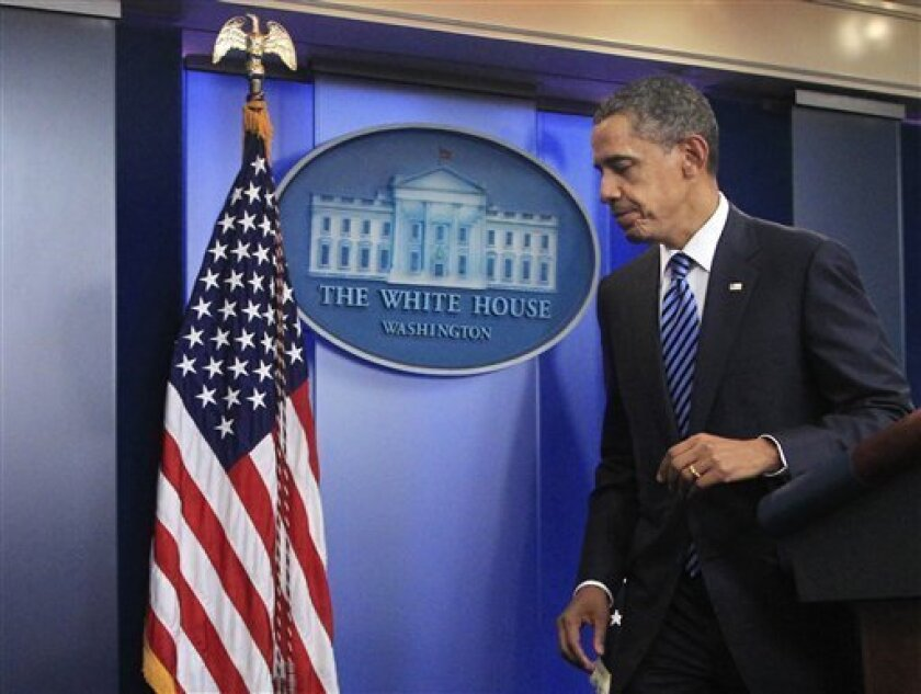 President Barack Obama leaves the Brady press briefing room of the White House in Washington Tuesday, July 5, 2011, after making a statement on the debt ceiling negotiations. (AP Photo/Manuel Balce Ceneta)