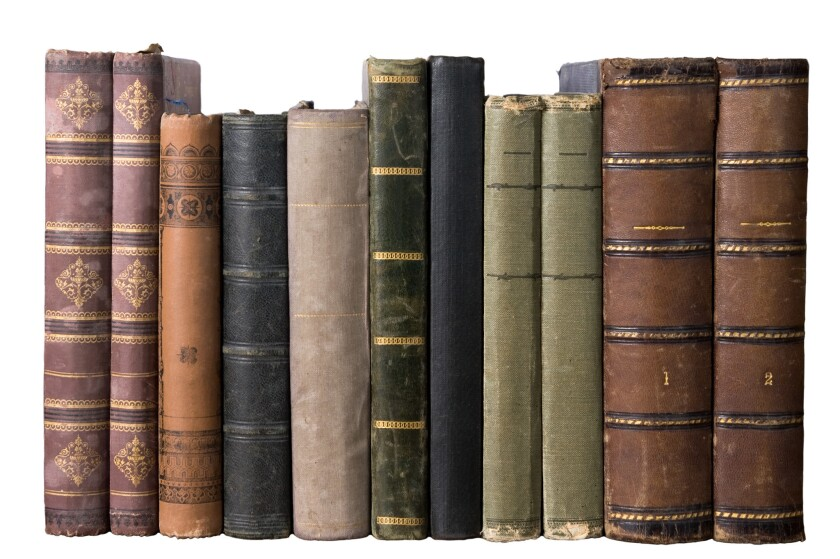 isolated row of antique books on white background