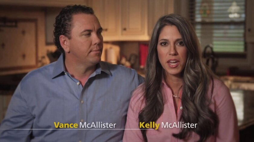 In this screen grab from a commercial posted on youtube.com, Rep. Vance McAllister, R-La., is seen with his wife Kelly McAllister. The Louisiana congressman whose re-election is threatened by a cheating scandal is putting his marriage front and center in the campaign. McAllister initially said he wouldn't seek another term after a videotape showed him passionately kissing a friend's wife. But McAllister's wife publicly forgave him, and he decided to run. Louisiana remains a rollicking and colorful battleground, even if that's not always intentional.(AP Photo)
