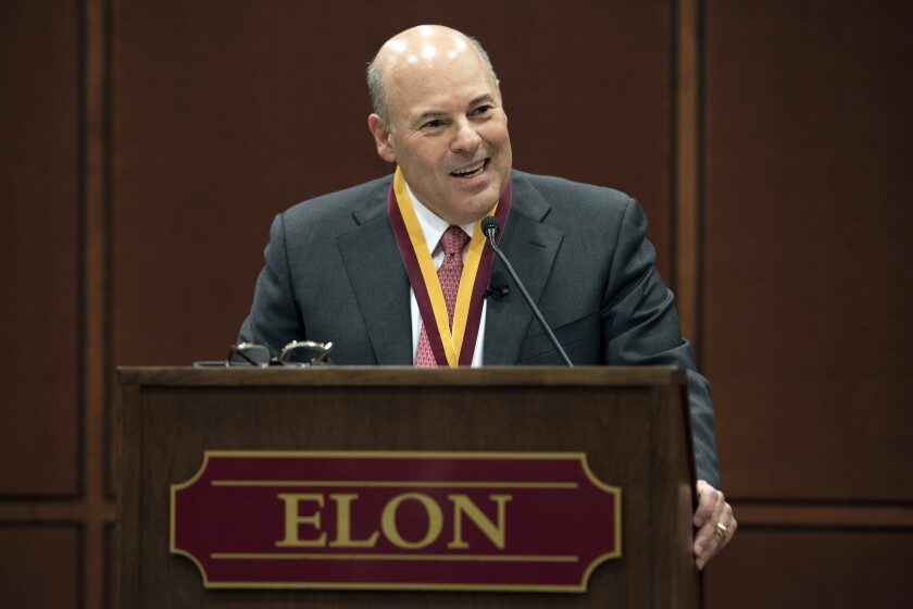 FILE - In this March 1, 2017, file photo, then Elon Trustee Louis DeJoy is honored with Elon's Medal for Entrepreneurial Leadership in Elon. N.C. U.S. Sen. Joe Manchin and union officials say the U.S. Postal Service is considering closing post offices across the country, sparking worries ahead the anticipated surge of mail-in ballots in the 2020 elections. Manchin on Wednesday, July 29, 2020 said he has received numerous reports from post offices and colleagues about service cuts or looming closures in West Virginia and elsewhere, prompting him to send a letter to Postmaster General Louis DeJoy asking for an explanation. (Kim Walker/Elon University via AP, File)