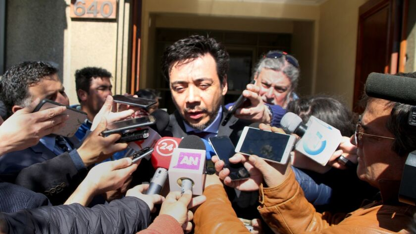 Emiliano Arias, who is investigating sex crimes in the church in Chile, talks with reporters at the Roman Catholic Church diocesan offices in Chillan.