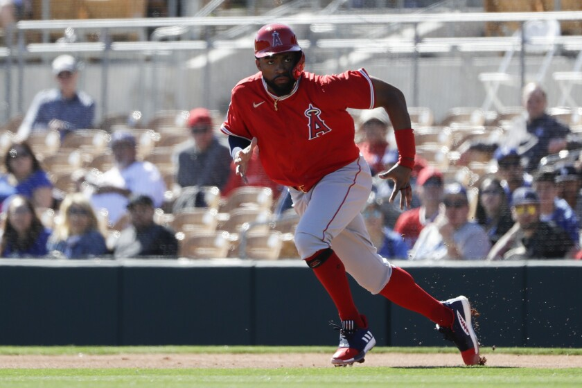 Angels outfielder Jo Adell runs towards second base.