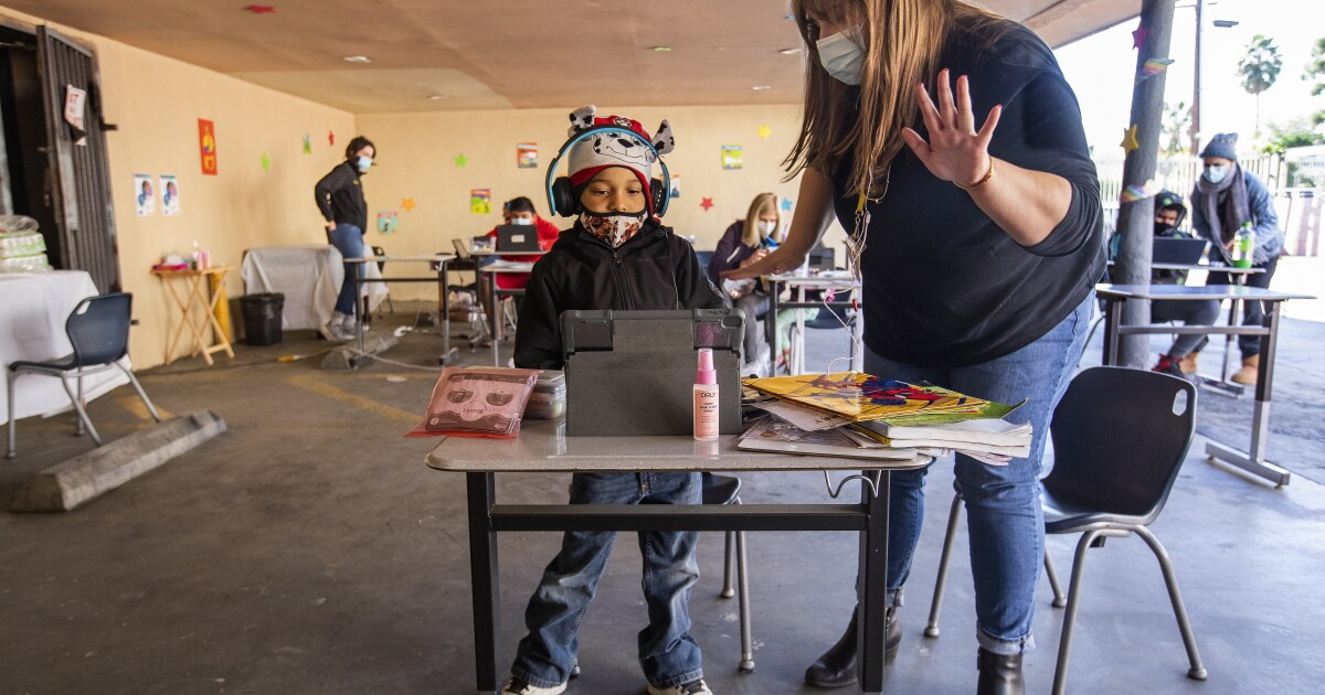 For a learning pod of homeless students, school days unfold in a motel carport