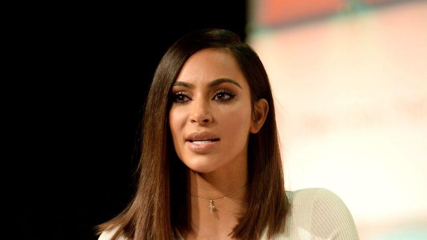 Kim Kardashian keynotes a conference in 2016.