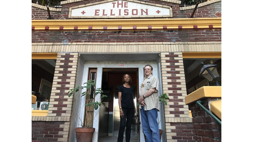 Attorney Amanda Seward and Bruce Kijewski in front of The Ellison. Seward works with Keep Neighborh