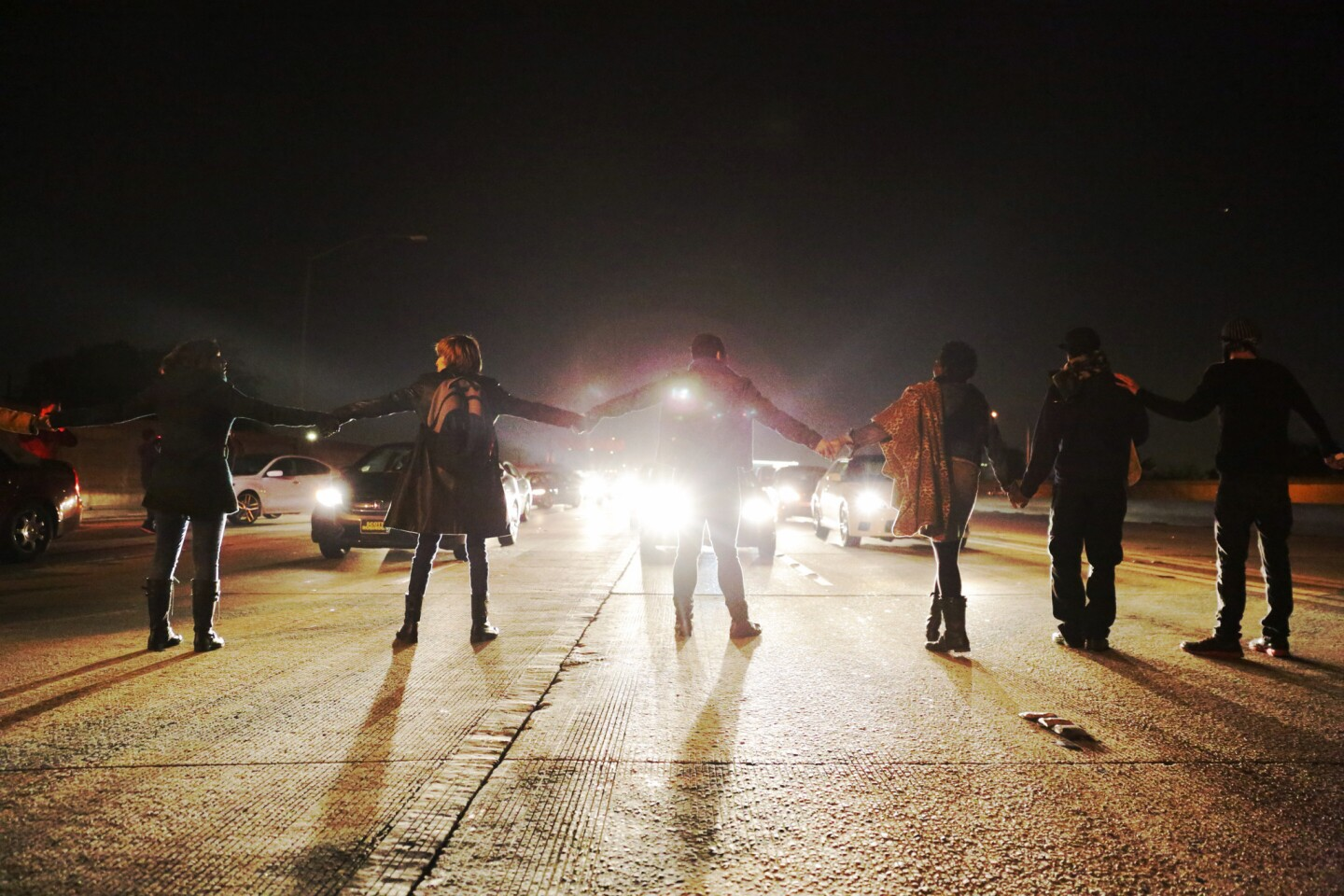 Demonstrators block the southbound 110 Freeway, protesting in the wake of the Ezell Ford's autopsy released in Los Angeles.