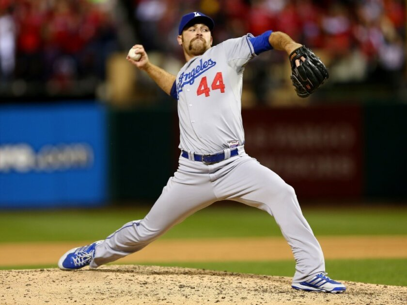 Chris Withrow pitches against the St. Louis Cardinals on Oct. 18.