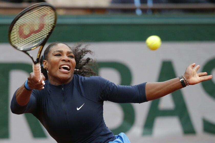Serena Williams of the U.S. returns the ball in the quarterfinal match of the French Open tennis tournament against Kazakhstan's Yulia Putintseva at the Roland Garros stadium in Paris, France, Thursday, June 2, 2016. (AP Photo/Michel Euler)