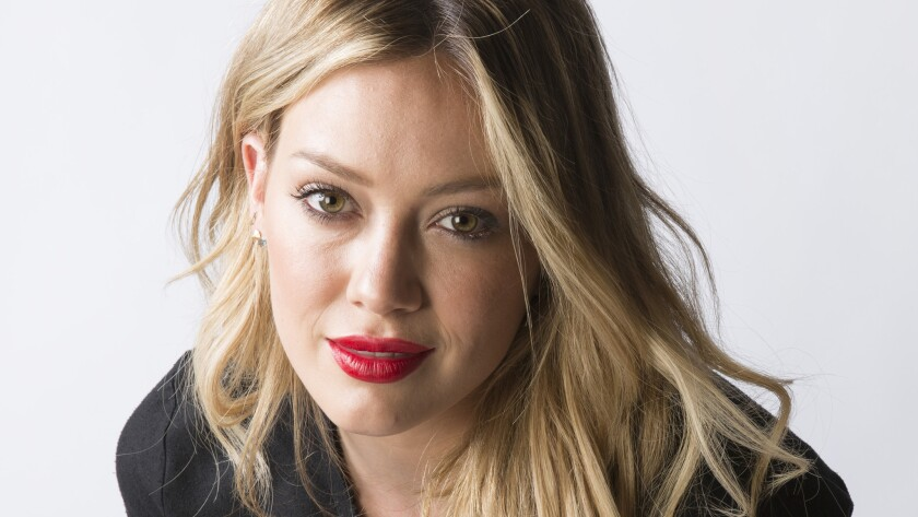 Hilary Duff was frustrated that police couldn't do anything about a man who was at the park taking photos of her son's football game.