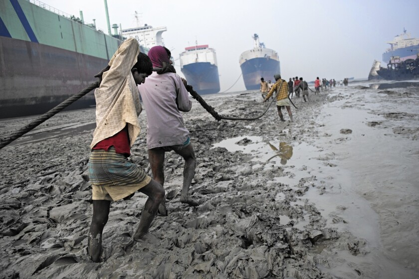 Laborers work in a ship-breaking yard on a beach in Chittagong, Bangladesh. Dozens of workers in the industry are killed or seriously injured each year in falls, explosions and other accidents.