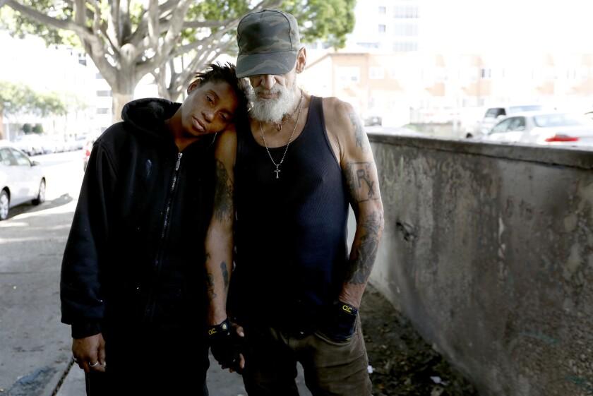 LOS ANGELES, CA MAY 13, 2018: Portrait of Leslie Whittington Silvia, left, 43, with Tony Maddogg,