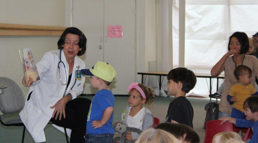 """Dr. Chrystal de Freitas reads """"Jake's Kindergarten Checkup"""" at the Rancho Penasquitos Library."""