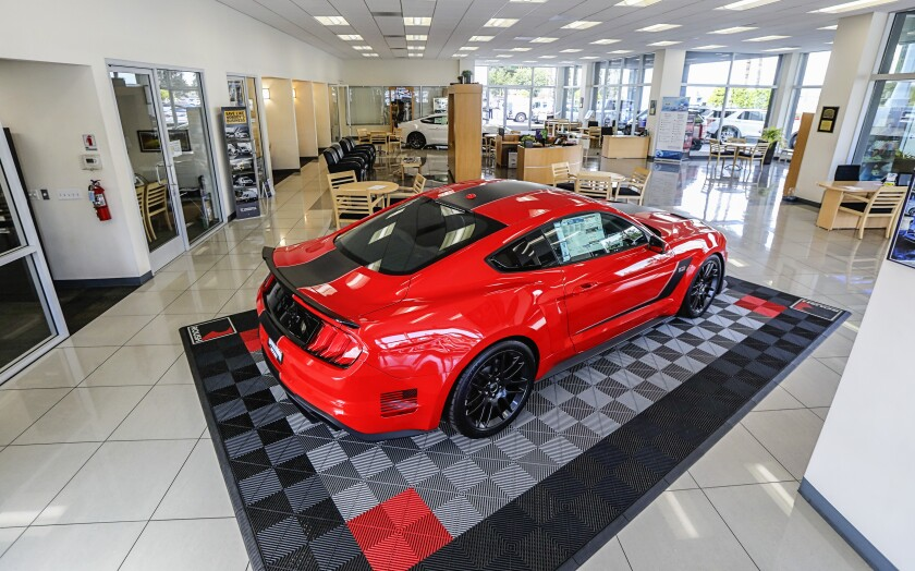 The showroom at El Cajon Ford sits idle after management decided to close its sales department due to the COVID-19 pandemic and California's stay-at-home orders. A limited crew is still working in the service department to work on cars.