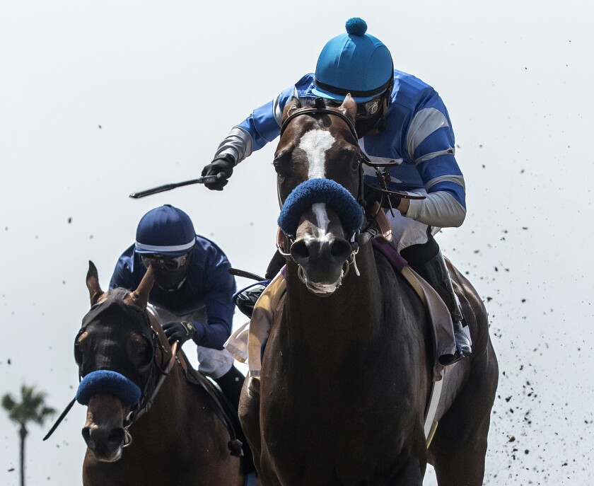 Thousand Words, right, with Abel Cedillo aboard, wins the Shared Belief Stakes on Aug. 1, 2020, at Del Mar.