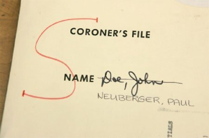 "A name has been written on a file once considered a ""John Doe"" case. (John Gibbins / Union-Tribune)"