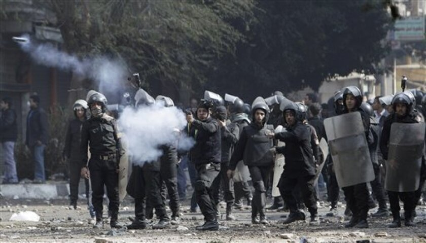 Egyptian riot police fire tear gas canisters at protestors, not pictured, during clashes near the Interior Ministry in Cairo, Egypt, Saturday, Feb. 4, 2012. (AP Photo/Muhammed Muheisen)