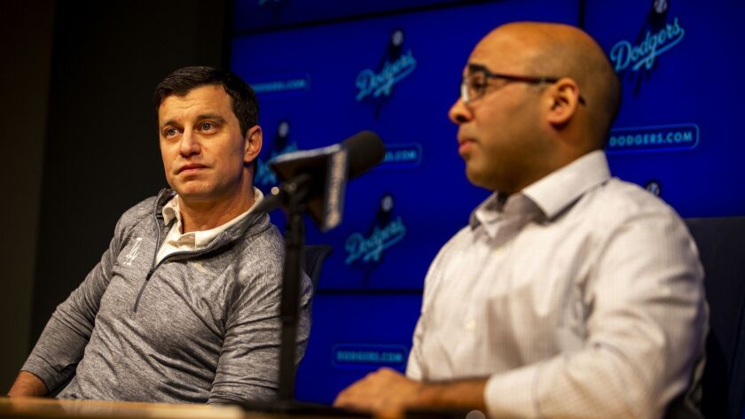 Andrew Friedman (right) and Farhan Zaidi (left) speak at a press conference at Dodger Stadium.