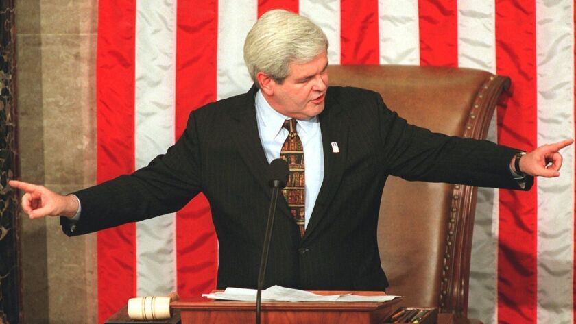 House Speaker Newt Gingrich gestures while addressing the opening session of the 105th Congress on Capitol Hill in Washington on Jan. 7, 1997.
