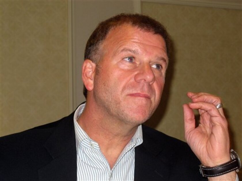 Tilman Fertitta, owner of the Golden Nugget Atlantic City, announces at a news conference at his Atlantic City, N.J., casino, on Friday, Aug. 31, 2012, that the casino will let gamblers cash in nearly $1 million worth of chips they won at card games in which the cards were not shuffled. Fertitta sp