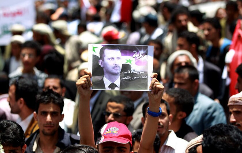 Supporters of Syrian President Bashar Assad march in the Yemeni capital, Sana, in protest of Israeli airstrikes on weapons convoys in Syria. Israel claims a right to prevent sophisticated arms from being acquired by the Hezbollah militia, although it has yet to confirm it waged the recent attacks.