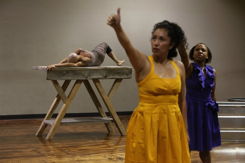 "Charlene Penner (background), as the Butterfly, is in a constant process of metamorphosis in Eveoke Dance Theatre's ""Las Mariposas."" In the foreground are Araceli Carrera (center) and Diondra Eubanks as two of the Mirabal sisters in their older years. Peggy Peattie • U-T photos"