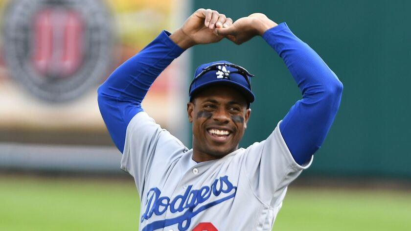 Los Angeles Dodgers Curtis Granderson warms up in the outfield before playing the Detroit Tigers in