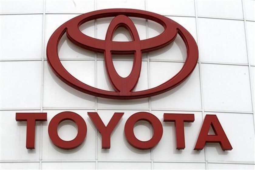 FILE - In this March 30, 2011 file photo, the Toyota logo is shown at Wilsonville Toyota, in Wilsonville, Ore. Toyota said Friday June 10, 2011 its profit for the fiscal year through March 2012 will fall 31 percent to 280 billion yen ($3.5 billion) in an outlook that underlines a robust recovery in the latter half of the fiscal year from the damage of the quake and tsunami. (AP Photo/Rick Bowmer)