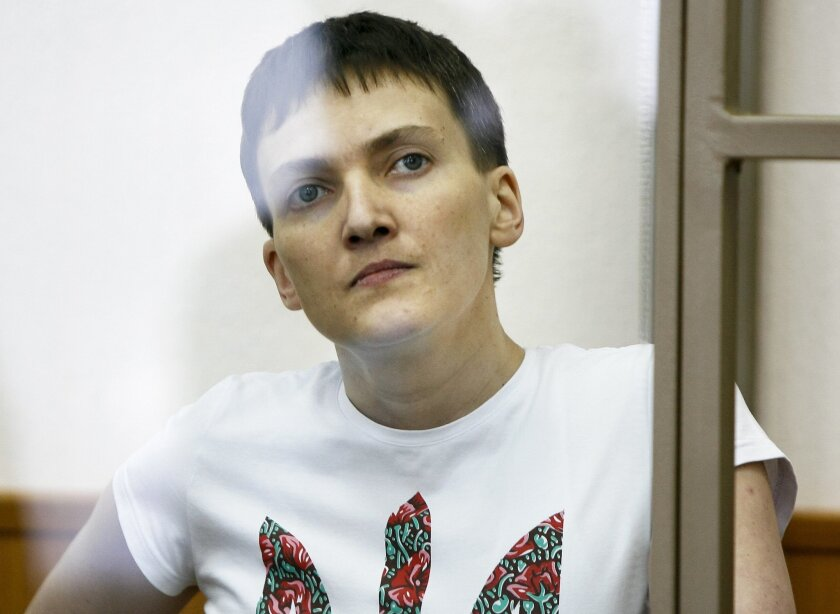 FILE - In this March 9, 2016, file photo, Ukrainian jailed military officer Nadezhda Savchenko as she sits in a glass cage during a trial in the town of Donetsk, Rostov-on-Don region, Russia. A judge of Donetsk is expected to deliver a verdict in the case of the Ukrainian pilot, charged with complicity to murder in the deaths of two Russian journalists in warring eastern Ukraine. The judge in Savchenko's trial is expected to begin reading the verdict on Monday but the sentencing is likely to be announced on Tuesday. (AP Photo/File)