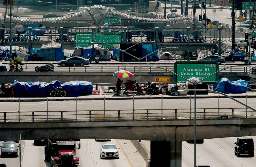 Homeless camps line Los Angeles, Main and Spring streets as they cross over the Hollywood Freeway in Los Angeles.