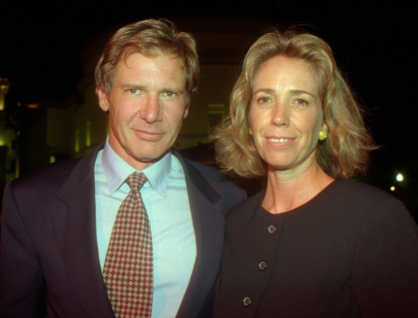 """Melissa Mathison and then-husband Harrison Ford attend the premiere party for """"Clear and Present Danger"""" on the grounds of Paramount Pictures on Aug. 3, 1994."""