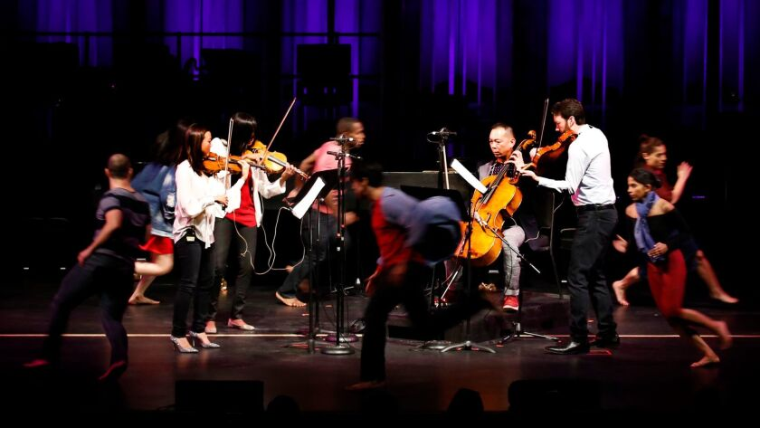 Dancers swirl around the Lyris Quartet during a Jacaranda Music tribute Saturday to composer John Adams at the Valley Performing Arts Center in Northridge.