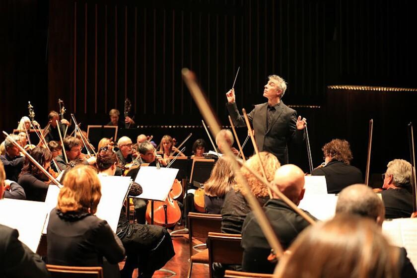 David Lockington conducts the Pasadena Symphony Saturday at the Ambassador Auditorium. It was Lockington's first concert as the orchestra's music director.