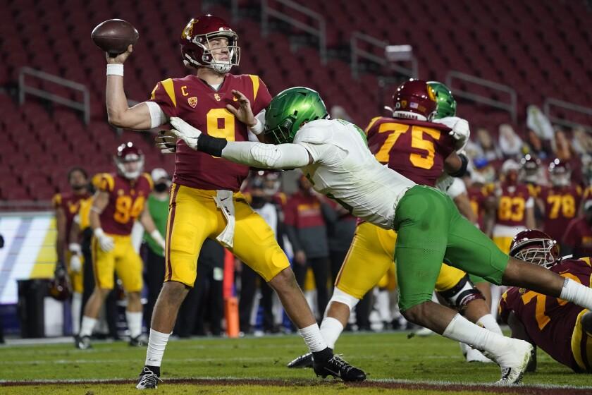 USC quarterback Kedon Slovis is tackled by Oregon defensive end Kayvon Thibodeaux.